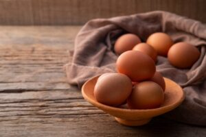 Eggs in clay bowl.